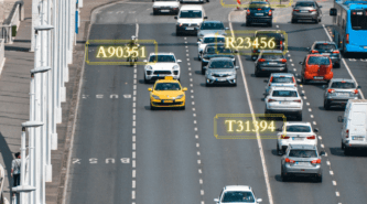 Cars running on a road along with numbers highlighted